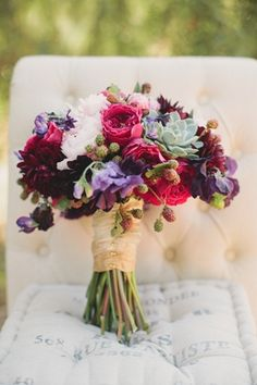 Bouquet with romantic pink and maroon florals, succulents, and blackberries