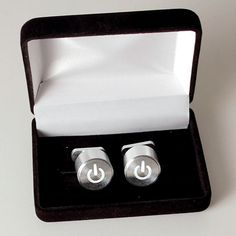 """iCufflinks from thinkgeek.com $127.99  **So, these little bad boys are actually a microcircuit board, with LED and battery.  The power symbol pulses like an apple """"breathing"""" power light because it was reverse engineered off the pattern.  I only have two shirts that require cuff links, and yeah I want these bad.**"""