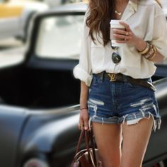 High waisted shorts.. Love this style, the blouse makes it very sophisticated and sexy