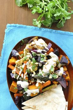 Middle Eastern Roasted Vegetables with Tahini Sauce {Vegan} - great way to use up leftover veggies, insanely simple, fabulous sauce!