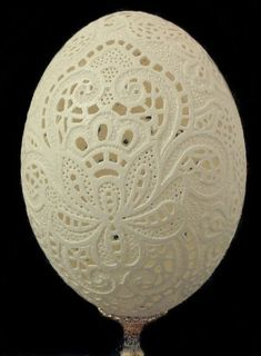 carved egg - looks like whitework / cutwork embroidery - really beautiful!