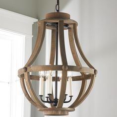 Rustic Wood Basket Lantern - Large Rough and rustic, this 6-light wood basket lantern is reminiscent of old fashioned wine barrel staves and is the perfect choice for a farmhouse, cottage or breezy coastal style home. This farmhouse chic lantern is the perfect addition to a foyer, kitchen, living room, bedroom or dining room.