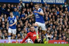 Wayne Rooney does his best to track back and stop Everton forward Kevin Mirallas driving on