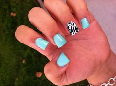 Fun, summer nails with turquoise & zebra print.