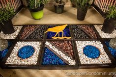 This is our atrium created by our gardener, Jan. We love what a great job she did with the colors and especially the blue glass stone! Beachfront Rentals, Mustang Island, Port Aransas, Atrium, Beach Resorts, Condo, Stone, Create, Colors