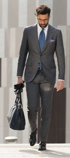 Charcoal grey windowpane suit, black leather gloves, black leather bag, light blue madder tie, lavender purple p square, white shirt