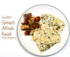 Crock Pot Spinach Alfredo Ravioli | a simple and really yummy crockpot meal! I have all these ingredients on hand!!!!!! Omfg! Pay attention felecia ;) !!!