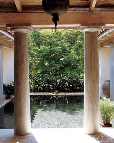 Shallow atrium pool paved with smooth pebbles, while the surrounding terrace is paved in antique terra-cotta tile