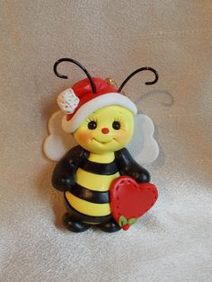 bee bumble bee bug sculpture Christmas ornament  sculpture figurine gift polymer clay. $15,95, via Etsy.