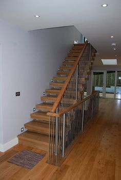 Metal balustrading for wooden staircase in The Sea House, Polzeath. Designed by The Bazeley Partnership Wooden Staircases, Wooden Stairs, House By The Sea, Interior Stairs, Love Your Home, House Stairs, Contemporary Design, Lights, Metal