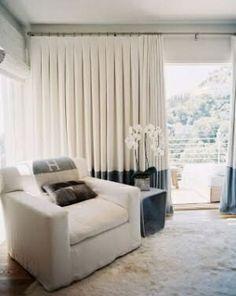interior design living lounge room white sofa white grey drape curtains hermes throw blanket