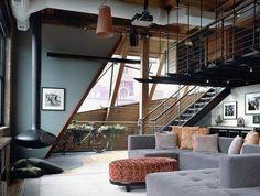 1-loft-et-associé-salon-style-industriel-avec-meubles-gris-et-moquette-beige-dans-le-salon-moderne