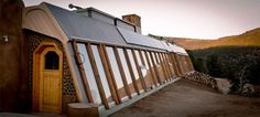 Earthship exteriors provide passive solar heat and light and make an excellent year-round food growing source.