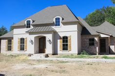 <ul><li>This French Country design has an open floor plan layout, with 4 bedrooms, 3 bathrooms.</li><li>From the foyer you have views extending through the family room and to the rear porch beyond.</li><li>The family room is the main gathering space of the house plan. It has a fireplace and is open to the kitchen and breakfast area.</li><li>The kitchen has a walk-in pantry and lots of counters plus an island. Groceries are made simple with easy garage access.</li><li>Tray ceilings in the…