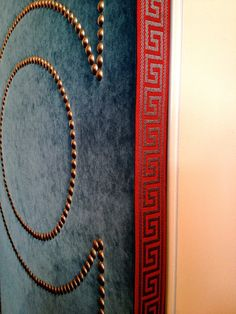 clever door detail at Wesley Hall. The greek key tape anchors this winning combination of color, texture and pattern Recycled Furniture, Diy Furniture, High Point Furniture, Upholstered Walls, High Point Market, Greek Key, Nailhead Trim, Door Design, Upholstery