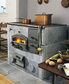 Tulikivi wood cooker is made from soapstone, on which you can cook and bake. The soapstone is incredibly dense so retains and radiantly heats for many hours. Also Tulikivi has a unique airflow design for exhaust that burns its own particulate matter, henc