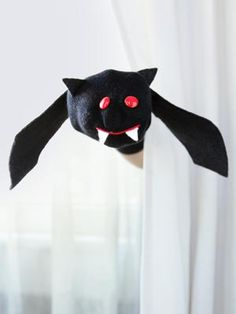 Halloween Craft Ideas for Kids -Sock Bat via Country Living -- finally, something to do with all those stray socks!