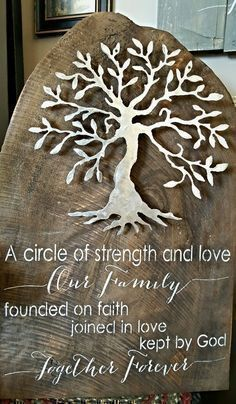 A circle of strength and love our family founded in faith joined in love kept by God together forever raw tree slab metal tree art. One of a kind locally made and available at Ann Marie's Gifts and Home Décor located in Beaverton MI find us on Facebook https://www.facebook.com/AnnMarieHeathCustomFlorals/