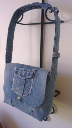 A cute little messenger bag made out of a pair of jeans. Handle is made from the waistband. I left the belt loops on for added interest.
