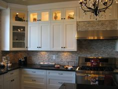 Tiny glass doors up top. With lighting. Bathroom Cost, Budget Bathroom Remodel, Kitchen Remodel, Basement Kitchen, Kitchen Dining, Kitchen Cabinets, Dining Room, Kitchen Eating Areas, Black Counters