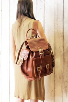 Backpack in brown leather, 100% Made in Italy. Vintage fabric lining. with is pockets its perfect for work or for sports activities.  Like all bags from La Sellerie Limited, also this backpack is one of a kind.  Free Shipping  31cm 14cm 37cm