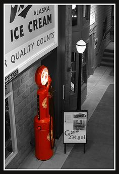 Red gas pump in color, converting the rest to black and white.
