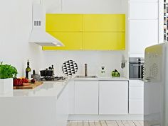 A fresh and bright design. We're huge fans on the yellow cabinets! #interior
