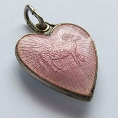 Scandinavian Guilloche Enamel Heart Charm. One side has a pink rose against white, the other a relief ram in pink enamel. Beautiful and unusual.