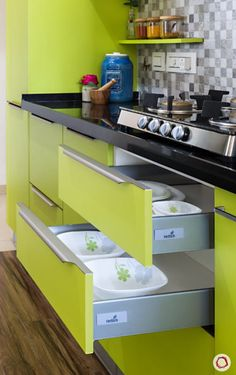 With perfect planning, even a small kitchen design can be dressed in vibrant colours.Check this lime green kitchen in Mumbai that looks bright and airy. Kitchen Cupboard Designs, Kitchen Units, Kitchen Trolley Design, Modern Kitchen Interiors, Interior Design Kitchen, Kitchen Layout Plans, Simple Kitchen Design, Kitchen Modular, Beige Kitchen