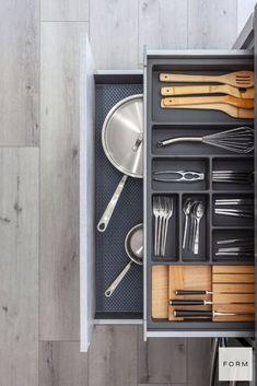 Elegant, organized kitchen drawer in this modern minimalist Scandinavian kitchen.