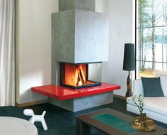 Cheminée Diablo, tablette en Silestone rouge, foyer Ruegg Pi compact.