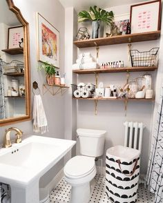 Before & After: A Gloomy Bathroom Brightens Up! See how this blogger freshened up her dingy, windowless bathroom. Nole Garey of Oh So Beautiful Paper turned her only full bath from a space that felt dark and cramped into a light and airy oasis with soft pastels and feminine touches.