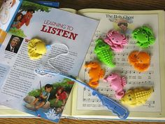 """Fishing for Phrases song review.  She shared a brief story (involving fishing, apparently) by Elder Jose A. Teixeira from Feb 2010 Friend magazine about listening to the Spirit before teaching The Holy Ghost. Then had kids """"go fishing."""" Each creature was marked for a different phrase in the song to sing."""