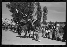Las Fiestas de Taos, a traditional celebration honoring the two saints of Taos (Santa Ana and Santiago), has been a mainstay of Hispanic culture for generations. The photo above shows the Fiestas parade in 1940 on Taos Plaza.  Taos News File Photo