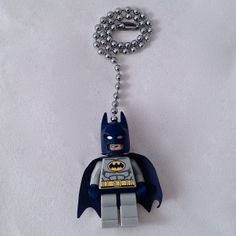 "Add a cool touch to any room with these Minifigure Super Hero Ceiling Fan Pulls . The decorative fan pull is approximately 2"" high x 1"" wide and made from a genuine LEGO Minifigure. The minifigure has full movement of arms, legs, and torso. The 6-inch chain and connector attaches easily to your existing fan pull chain. If you would like a Fan/Light Pull Minifigure not listed here, please send a request and we will get it done for you! Customer satisfaction is our 'primary objective' Enjoy…"