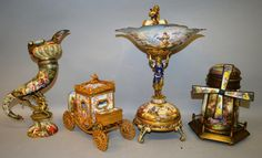 A good collection of Vienna enamelled items; including shaped comport, windmill, carriage and cornucopia. Various estimates.
