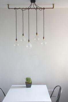 Lumière décalage - Simple lighting detail. Urban Cottage Industries. Pendant Lights. Filament Bulbs.