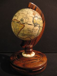 bing mages of elephant ivory jewelry | Ivory Globe