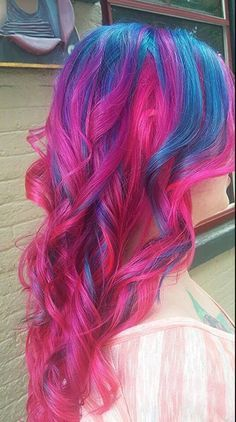 Bright blue and vibrant pink tresses. #curls bright hair #blue #pink #hair