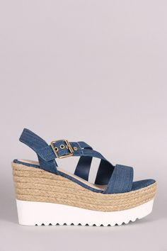 """Bamboo Denim Asymmetrical Strappy Flatform Wedge. Description This stylish  flatform wedge  features an open toe silhouette, asymmetrical straps denim upper, woven faux straw midsole, slingback construction and lug sole. Finished with a lightly padded insole for comfort and side buckle closure.Material: Vegan Leather/Denim (man-made)Sole: Treaded  Measurement Heel Height: 4"""" w/ 2"""" Platform (approx)"""