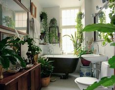 Don't like the Bathroom style, and it's a little too over done, but I so love the Idea of having greenery in the bathroom.  I love the hanging plants.