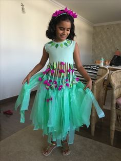 Buganvillea flower costume: crepe paper flowers and a plastic bag skirt!