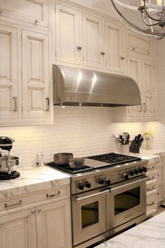 O.M.G. Loving these traditional cabinets with the gas stove and AMAZing hood. Not to crazy about jogging countertops though. Why do people do those!