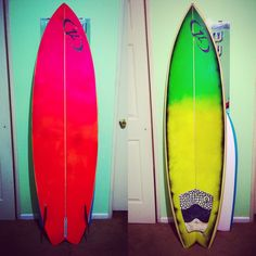 This is my twin fin board I spray painted with fluorescent pink, orange, yellow, and green. Added some black to pop out the yellow and green.