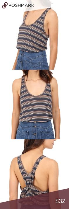 """Free People """"Best Night"""" Linen tank Sz M Free People Women's """"Best Night"""" Linen racetrack tank. In Sz M. Brand new with tags! Retail price is 58$ fantastic Navy And pastel stripe detailed fabric, cool twist in back. Fabric is a nice heavy weight.   PRODUCT INFORMATION: Colored striping creates a vintage look to this chic tank. Lightweight linen fabrication. Deep scoop neckline. Twist detail at back gives a peek-a-boo look. Sleeveless design. Shirttail hemline. 100% linen. Hand wash cold, dry…"""