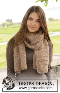 "Knitted DROPS scarf in garter st with dropped sts in ""Brushed Alpaca Silk"". ~ DROPS Design @dropsdesign #knit #scarf"