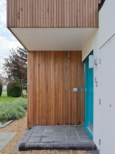 turquoise contrasts with the Siberian larch siding - nice! Larch Cladding, Exterior Cladding, Wooden Facade, Local Architects, Timber House, House Extensions, Facade House, Modern Exterior, House Front