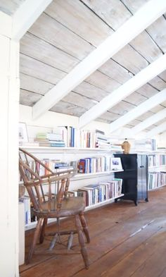 Calling all book worms: You're going to want to transform your attic into a library, complete with a chair for mini reading breaks, after you see this home transformation.