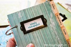 "The tabs of the notebook are entitled: Notes, Inspirations, Cards, Contacts, Codes, Colours, Blogs, Photographs, Passwords, and The End. ""The End"", which will say: Scripture, Quotes, Recipes, Important Dates, and Post Ideas."