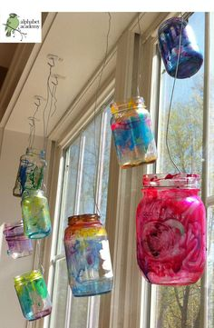 We painted used, recycled glass jars brought from home with glass stain and hung them from our sunniest window! — Alphabet Academy North Pre-K http://thealphabetacademy.com ≈ ≈